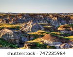 sun setting over dinosaur... | Shutterstock . vector #747235984