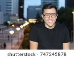 cute ethnic male smiling in the ... | Shutterstock . vector #747245878