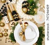 christmas table setting. gold... | Shutterstock . vector #747246409