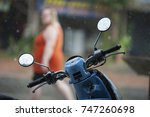 a motorbike is parked outside a ...   Shutterstock . vector #747260698