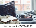 cozy home with cup of tea with... | Shutterstock . vector #747264253