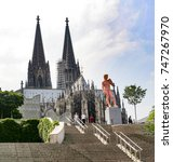 Small photo of COLOGNE, GERMANY - MAY 23, 2007: Adam from Michelangelo in Pink is standing in front of the cologne dome in Cologne, Germany. Cologne is the German capital for gay people.