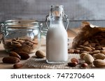 a bottle of almond milk on a...   Shutterstock . vector #747270604