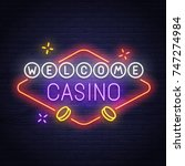 casino neon sign. slots. pocker.... | Shutterstock .eps vector #747274984