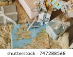 airplane is on the map among... | Shutterstock . vector #747288568