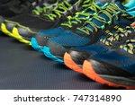 three pairs of running shoes  ... | Shutterstock . vector #747314890