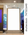 Small photo of Blank billboard advertising panel in terminal airport, Mock up white, insert for text of customer. Space for texting your products or promotional.