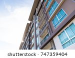 image of condo on afternoon | Shutterstock . vector #747359404
