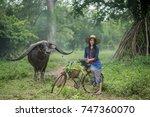 thai beautiful woman riding...   Shutterstock . vector #747360070