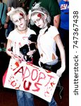 Small photo of Asbury Park, New Jersey - October 7, 2017: These young twin female zombies were trying to be adopted at the 10th annual Asbury Park Zombie Walk
