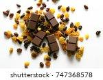 raisins and chocolate   a... | Shutterstock . vector #747368578