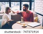 young woman and man talking... | Shutterstock . vector #747371914