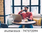 positive hipster guy talking on ...   Shutterstock . vector #747372094