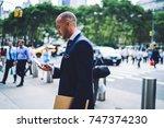 cheerful businessman in... | Shutterstock . vector #747374230