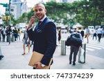 cheerful businessman in... | Shutterstock . vector #747374239