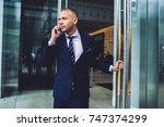 confident male entrepreneur... | Shutterstock . vector #747374299