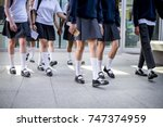 group of students walking at... | Shutterstock . vector #747374959
