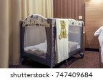 a gray portable baby bed for...   Shutterstock . vector #747409684