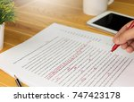 hand working on paper for... | Shutterstock . vector #747423178