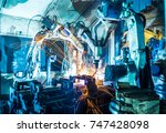 welding robots movement in a... | Shutterstock . vector #747428098