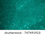Blurry Turquoise Glitter Bokeh...
