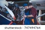 two flight mechanics doing a... | Shutterstock . vector #747494764
