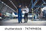 mechanic and flight engineer... | Shutterstock . vector #747494836