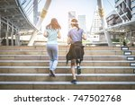 two women jogging on the stairs.... | Shutterstock . vector #747502768