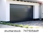 modern new garage door ... | Shutterstock . vector #747505669