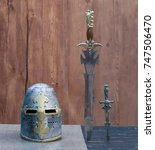 Small photo of sword and helmet, crusader
