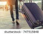 traveler with suitcase in... | Shutterstock . vector #747515848