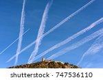 many chemtrails on blue sky... | Shutterstock . vector #747536110