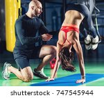 personal trainer with woman in... | Shutterstock . vector #747545944