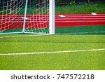 football field with artificial... | Shutterstock . vector #747572218