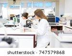 beautiful young scientist...   Shutterstock . vector #747579868