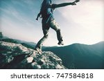 brave woman hiker walking to... | Shutterstock . vector #747584818