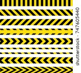 yellow and black danger ribbons.... | Shutterstock .eps vector #747605440