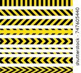 yellow and black danger ribbons.... | Shutterstock .eps vector #747605440