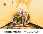 view from camping tent on family looking at it - stock photo