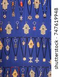 Small photo of Necklaces with Hamza or Fatimas hand and other symbols of MENA region.