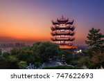 "Yellow Crane Tower at twilight, the traditional Chinese multi-storey tower located on Sheshan (Snake Hill) in Wuhan, Hubei, China, 4 Chinese letters on tower is ""Mu Ji Tian Chu"" means ""amazing heaven"""