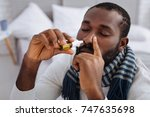 calm concentrated man curing... | Shutterstock . vector #747635698