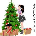 girl decorates the christmas...   Shutterstock .eps vector #747650464