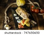 fish cooked and place in a... | Shutterstock . vector #747650650