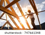 roofer carpenter working on...   Shutterstock . vector #747661348