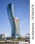 Small photo of ABU DHABI, UAE - January 05: The Capital Gate Skyscraper (also known as the Leaning tower of Abu Dhabi) in Abu Dhabi City. January 05, 2017 in Abu Dhabi, United Arab Emirates