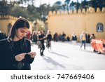 female tourist buying ticket to ... | Shutterstock . vector #747669406