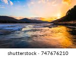 Stock photo winter mountain forest river snow sunset panoramic landscape 747676210