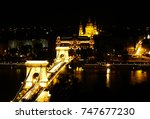 the chain bridge by night with... | Shutterstock . vector #747677230