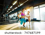fitness slim girl doing one leg ... | Shutterstock . vector #747687199